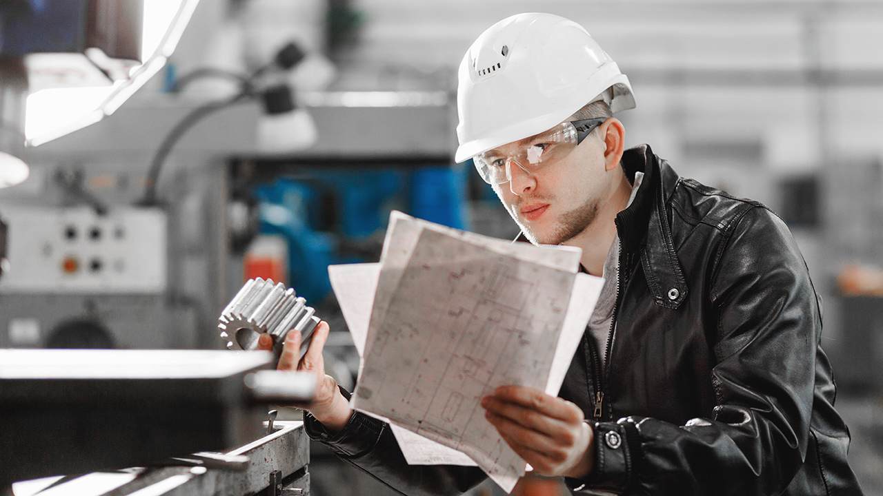 Factory-engineer-checks-the-quality-of-the-manufactured-part