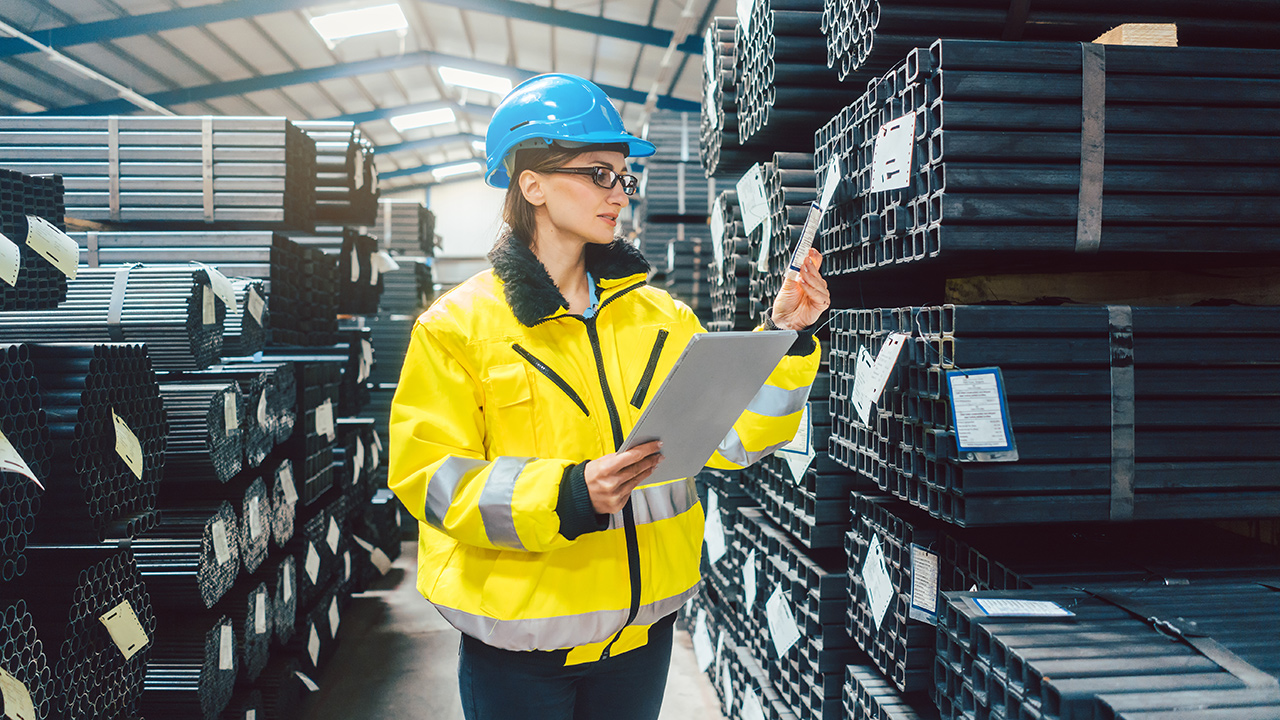 Woman-worker-checking-the-inventory-in-a-steel-warehouse